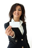 Business woman hand holding an empty business card. Over white background Royalty Free Stock Photo