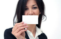 Business woman hand holding an empty business card Stock Photo