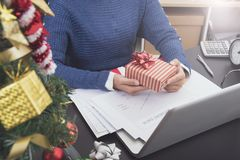Business woman hand holding gift box on desk office. Concept office christmas and happy new year Royalty Free Stock Photos