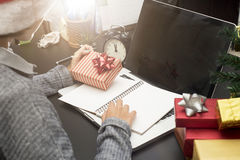 Business woman hand holding gift box working on desk office Royalty Free Stock Photos