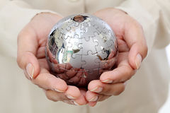 Business woman hand holding jigsaw puzzle globe Royalty Free Stock Photography