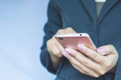 Business woman hand holding mobile phone connecting to internet Royalty Free Stock Photos