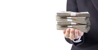 Business woman hand holding Thai money Stock Photos
