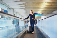 Business woman with hand luggage in international airport Royalty Free Stock Images