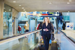 Business woman with hand luggage in international airport Stock Photos