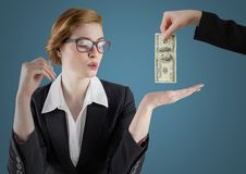 Business woman with hand out and business hand with money against blue background. Digital composite of Business woman with hand out and business hand with money stock image