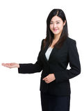 Business woman with hand present Stock Photos