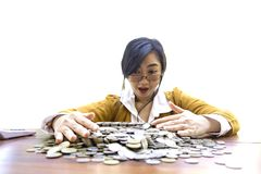 Business woman Hand Protecting With Stacked lots Coin, Portrait of beautiful happy young lady hands Pick up lots money on wooden t royalty free stock photography