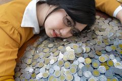 Business woman Hand Protecting With Stacked lots Coin, Portrait of beautiful happy young lady hands Pick up money royalty free stock photos