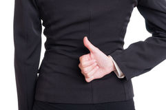 Business woman hand showing like behind back Stock Photos