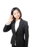 Business woman with hand to ear listening Royalty Free Stock Images