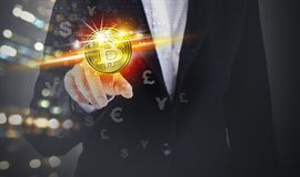Business woman hand touching bitcoin and currency symbol Royalty Free Stock Image