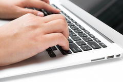Business woman hand typing on laptop keyboard Royalty Free Stock Photos