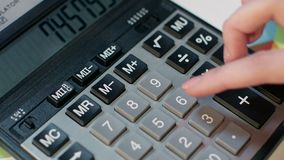 Woman using calculator. Business accounting and money profit calculation. Business woman hand using calculator at office. Business accounting and money profit stock footage