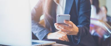 Business woman hand using mobile phone in office.Web banner stock photography