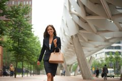 Business woman with handbag walking Royalty Free Stock Images