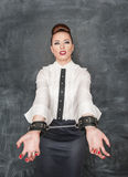 Business woman with handcuffs on her hands Royalty Free Stock Image