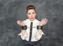 Business woman with handcuffs on her hands Royalty Free Stock Photography