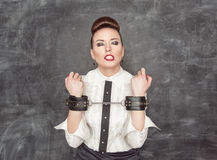 Business woman with handcuffs on her hands Stock Images