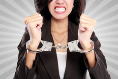 Business woman in handcuffs Stock Photography
