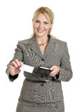 Business woman handing out card. A business woman handing out her business card isolated on white Royalty Free Stock Image