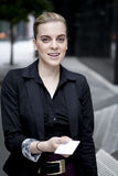 Business woman handing over business card Stock Image
