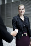 Business woman handing over business card Stock Photography