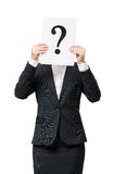 Business woman handing question mark in front of face Stock Image