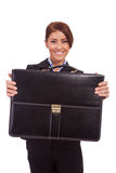 Business woman handing a suit case to you Royalty Free Stock Photos