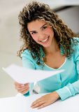Business woman handling documents Royalty Free Stock Photography