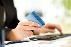 Business woman hands with credit card and keyboard. Business woman hands with credit card typing on keyboard for online payment Stock Photography