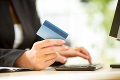 Business woman hands with credit card. Typing on keyboard Royalty Free Stock Photo