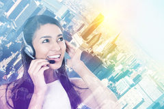 Business woman with hands free device talking to customer Royalty Free Stock Photo