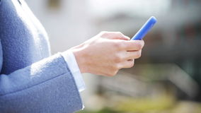 Business woman hands with smartphone texting stock footage