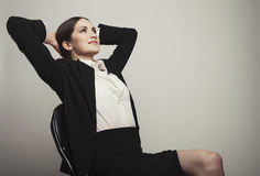 Business woman hands up  sit on chair Stock Image