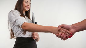 Business woman handshaking with an other person -