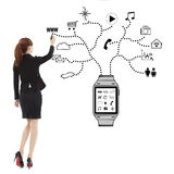 Business woman handwriting wearable watch applications. In studio royalty free stock photo