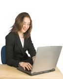 Business woman happily using her laptop Stock Images