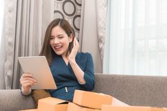 Business woman happy with her online order for her online business. Business woman is happy with her online order for her online business Stock Photos