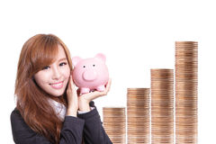 Business woman happy holding piggy bank Royalty Free Stock Images