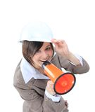 Business woman in hard hat speak in megaphone. Top view of business woman in hard hat speak in megaphone Royalty Free Stock Photos
