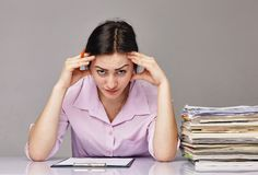 Business woman at hard office work Royalty Free Stock Photography