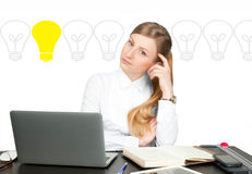 Business woman has an idea. Brainstorm and Light bulbs Royalty Free Stock Image