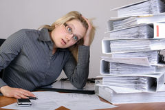 Business woman has stress in office. Business woman has stress because of a lot of work Royalty Free Stock Image