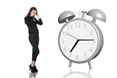 Business woman have a headache.Alarm clock Royalty Free Stock Photography