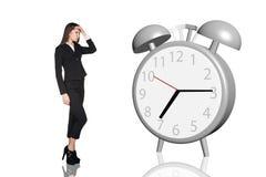 Business woman have a headache.Alarm clock Stock Photography