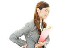 Business woman having back pain. Stock Photos
