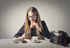Business woman having breakfast Royalty Free Stock Photos