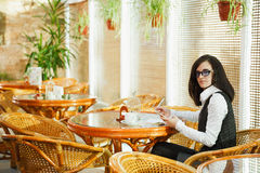 Business woman having breakfast in a cafe with coffee, not being Royalty Free Stock Photo