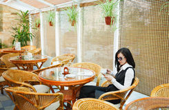 Business woman having breakfast in a cafe with coffee, not being Stock Photography